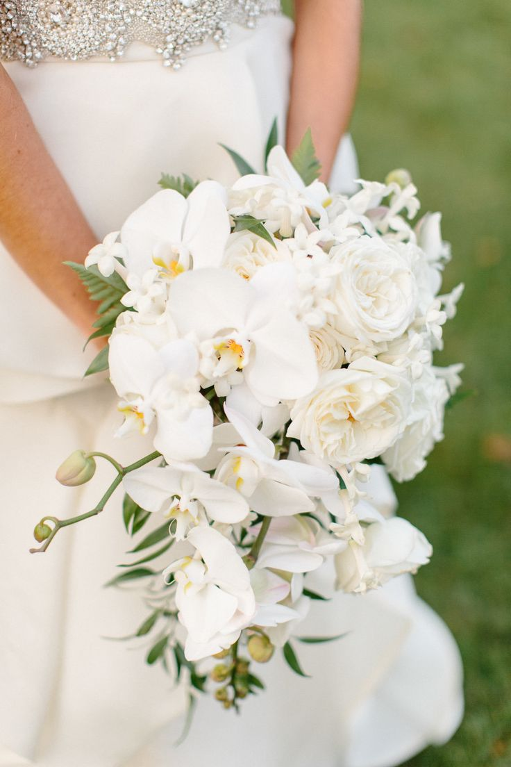 Overflowing white orchid bouquet | Photography: Morrissey Photo - morrisseyphoto.net  Read More: http://www.stylemepretty.com/2014/05/07/elegant-philadelphia-country-club-wedding/