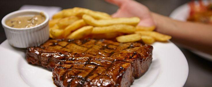 Hurricane's Grill T-Bone Steak with chips and mushroom sauce
