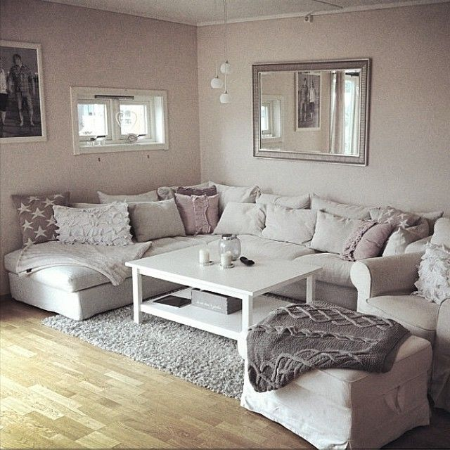 Love everything about this living room. #Livingroom #cozy #cocooning #homesweethome #pillows #sheepskin #sequins #grey #white #rose #silver #candles #blankets