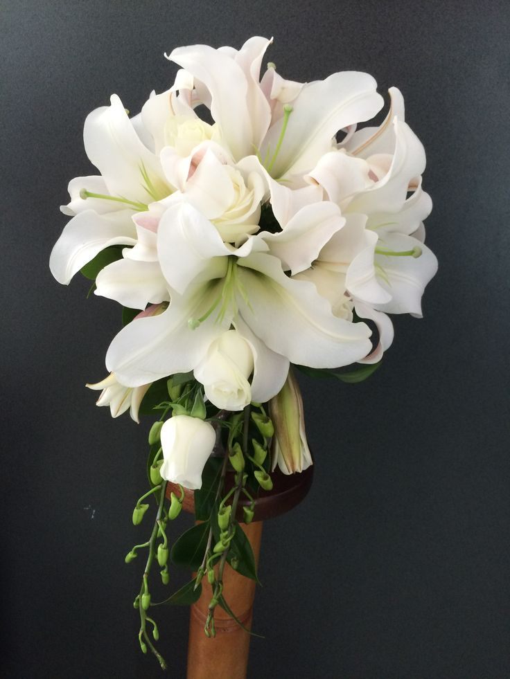 Stunning all white oriental lilies, roses & dendrobium orchids teardrop style bouquet