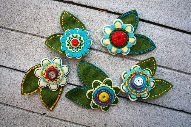 Felt flower corsages for the wedding party. Love the details!