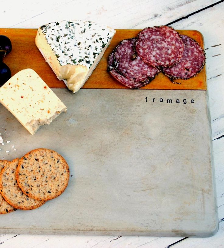 Concrete Cheese Board crafted with hand-poured concrete and sealed with a food-safe sealer.