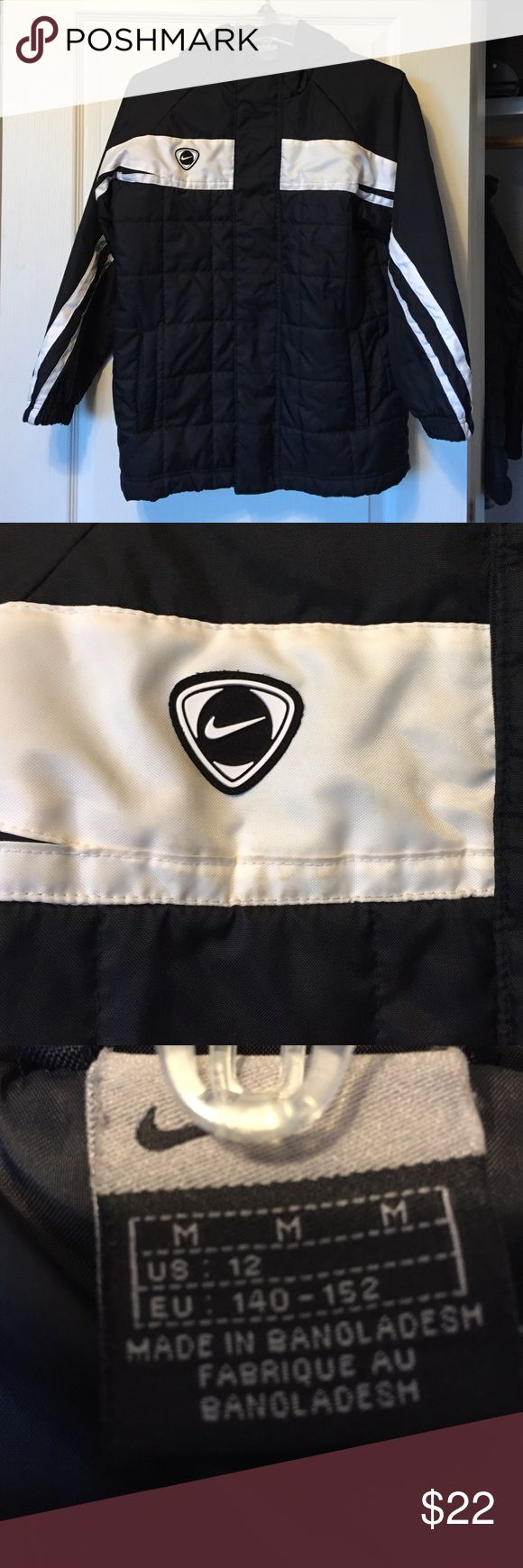 Boys Nike Coat 12 Medium Black and white.  Hooded.  Hood. Front has zipper and snaps.  Elastic at cuffs.  Insulated coat.  Worn two times - there is dirt on the front stripe - I think it will wash right out. Nike Jackets & Coats Puffers
