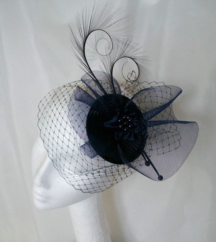 Navy Blue Veiled Matilda Feather & Crinoline Fascinator Order Now from www.indigodaisyweddings.co.uk Specialising in stunning bespoke cocktail fascinators and formal hats in a wide range of colours, perfect for Royal Ascot and The Kentucky Derby. Plus all your wedding floral accessories including shoe clips, bandeau veils,vintage flapper bands, feather and flower fascinators, feather fans, fairy wands, wrist corsages, wedding bouquets & buttonholes. Worldwide Delivery. #wedding #fascinator #