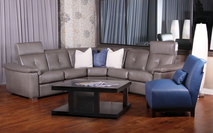 Sacha grey leather sectional by Jaymar. Retractable head-rest and Motorized reclining mechanism. Sofa made in Canada.