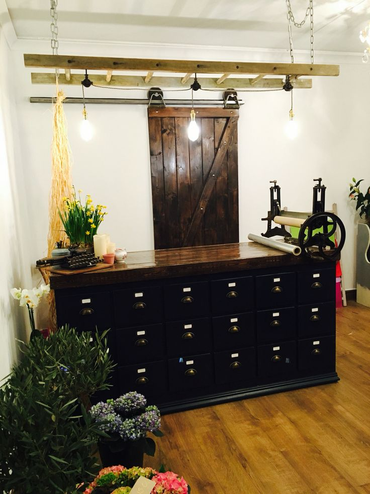 Beautiful flower shop . Custom made counter , barn door , lights etc