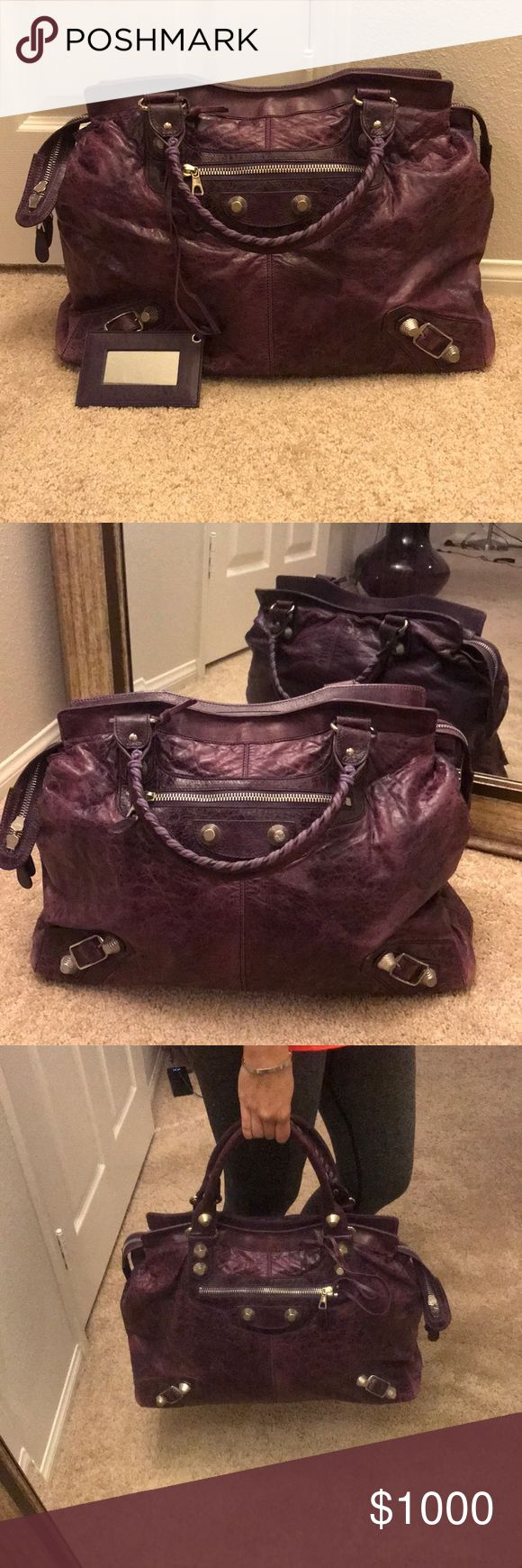 Balenciaga Weekender XL Bag in Purple This is an oversized weekender bag in a dark purple. The leather is super soft but is textured. It has silver big studs in Balenciaga fashion. Great condition, there is only one minor stain on the inside of the bag but barely visible. Bought in 2009 but only used like 10 times. It is totally authentic, and comes with leather framed mirror.  Measurements: 17 inches wide, 13 inches high without handle, 6 inches depth. Balenciaga Bags Totes