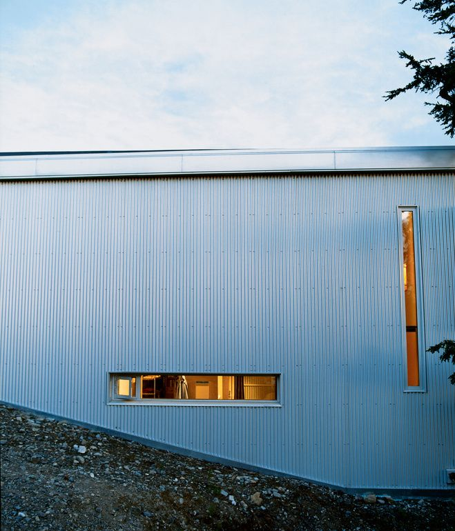 """Sattler-Smith explains that """"the north side of the house is covered with corrugated galvanized steel and pierced with only a few very small windows; this protects from the 100-mile-per-hour north winds."""" Photo by Dave Lauridsen."""