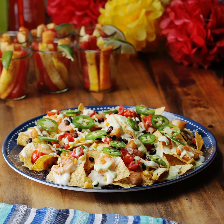 Spicy Shrimp Nachos  Get the fiesta going on Cinco De Mayo with firey, Spicy Shrimp Nachos topped with a zesty, lime-yogurt drizzle made with Chobani Non-Fat Plain Greek Yogurt. http://cho.ba/2njAxBC