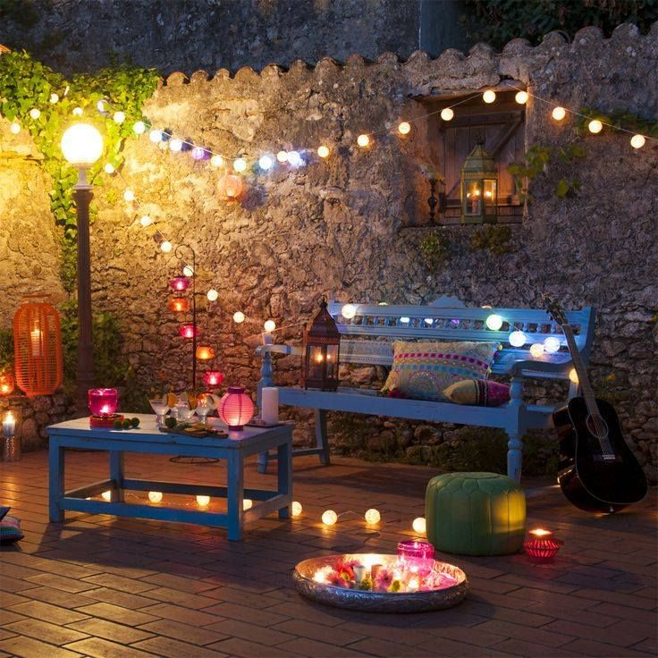 Wooden bench and string lights.