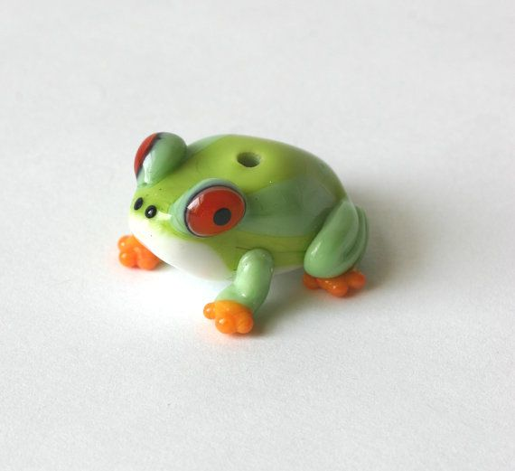Frog bead    From Life in a Country series.    Handmade in Tweed, Ontario,Canada by Artist Lucie Kovarova-Weir of Lunacy Glass Studio.  Lunacy Glass is small family based glass studio in Tweed, established in fall of 2002.    Main productions of Lunacy Glass are Flame worked glass beads, small objects and finished jewelry. They are all created with love and enthusiasm in original designs and small series.    Enjoy!    Thank you for looking. Please see my other listings.