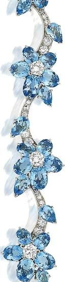 Cartier aquamarine and diamond bracelet, circa 1950 Composed of oval and pear-shaped aquamarine floral clusters with brilliant-cut diamond stamens, on a meandering brilliant and single-cut diamond stem.