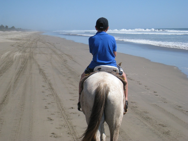 horseback riding on a secluded 10 mile long beach with only our guide and family...awesome does not even begin to describe it