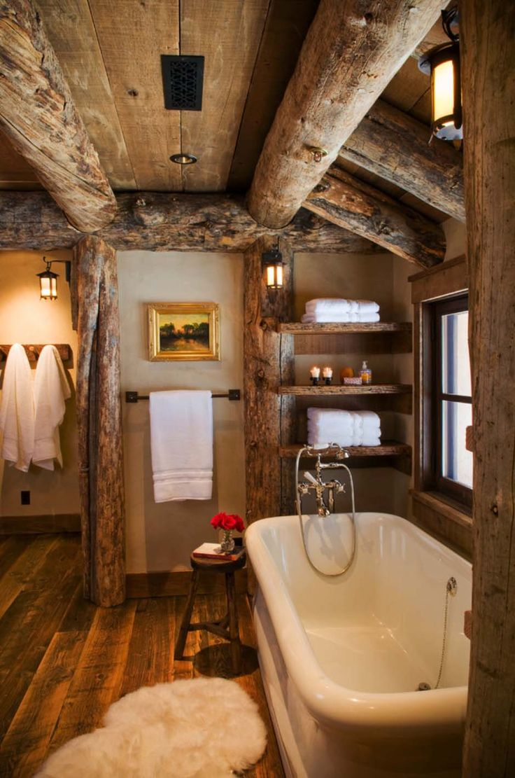 Rustic master bathroom with log walls amp undermount sink zillow digs - Rustic Elegance Re Defined In A Big Sky Mountain Retreat