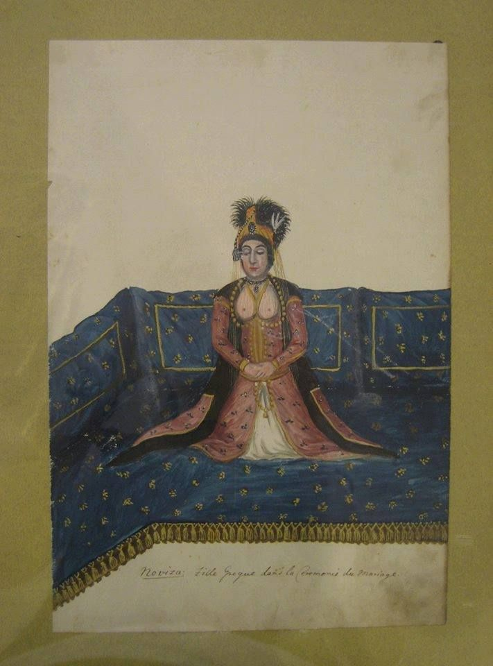 """Watercolour: """"Young Greek woman resting at the sofa playing her komboloi"""".© Peloponnesian Folklore Foundation, Nafplion, Greece."""