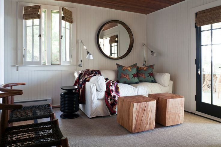 The richness of our Nguni chairs and storage side table ground this beautiful space by Jennifer Worts