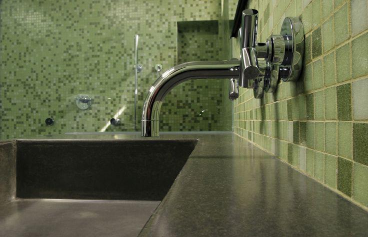 Custom dark gray top with integral concrete sink.