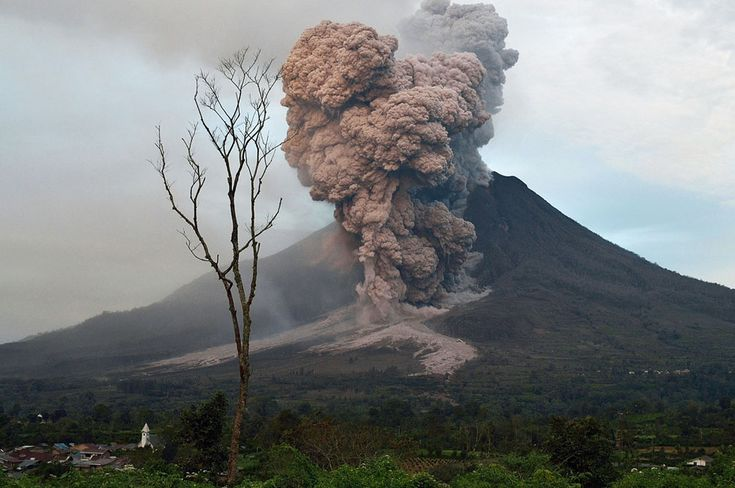 Sinabung spews ash into the air during an eruption near Karo, North Sumatra, on January 8, 2014.