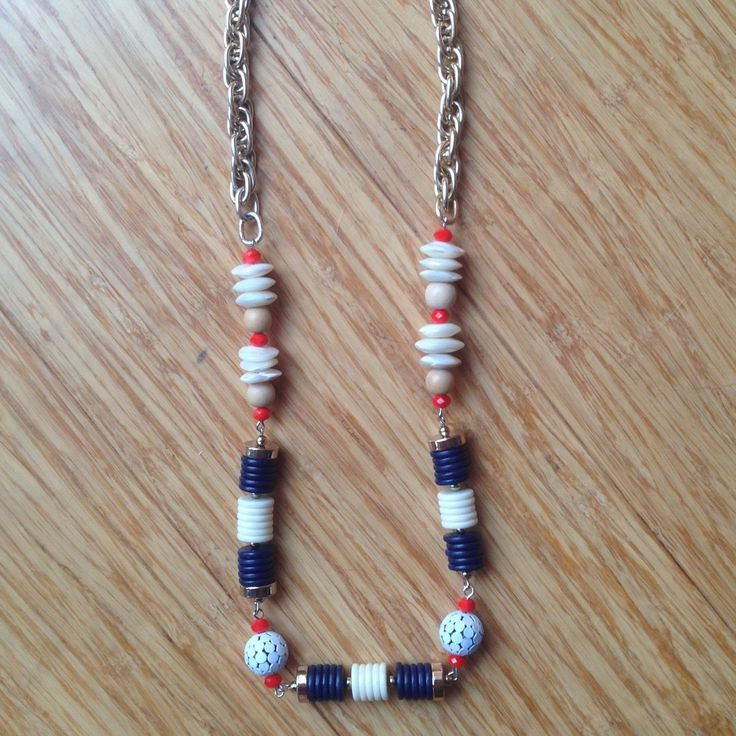 Long Bead necklace.  Recycled beads from 3 other necklaces and also some new beads combine to make this long necklace.   Bright orange glass, shell, wooden, navy blue disc beads and metallics red and white beads link together with gold colour chain.