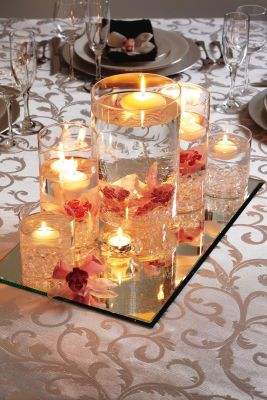 Beautiful Centerpiece    Mirrors are hard to find! Got mine at Home Depot, some Hobby Lobbies have them too.   put colored marbles in the bottom of the cylinders instead, to add a little more color    Fast, easy, & really pretty final product