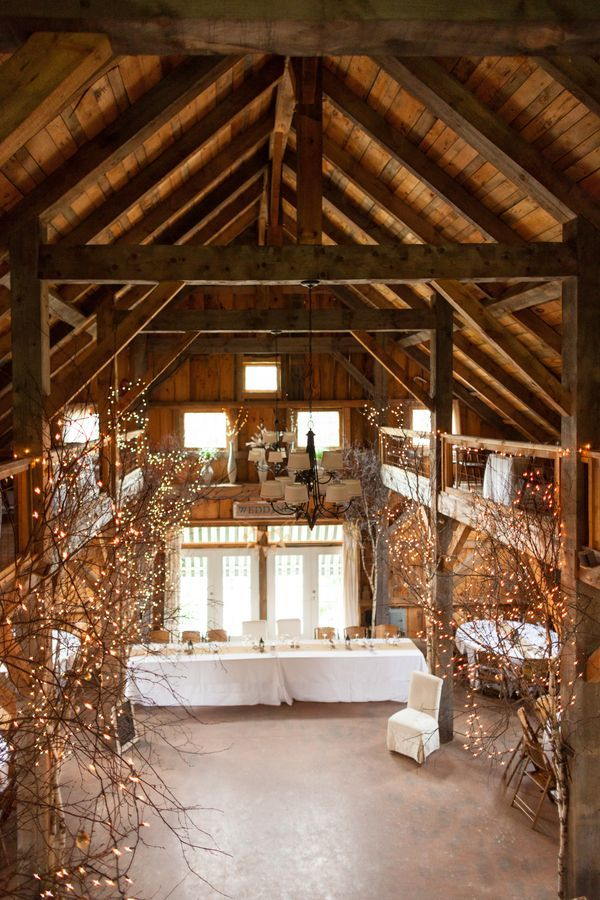 rustic country barn wedding decor with lights / http://www.deerpearlflowers.com/30-romantic-indoor-barn-wedding-decor-ideas-with-lights/