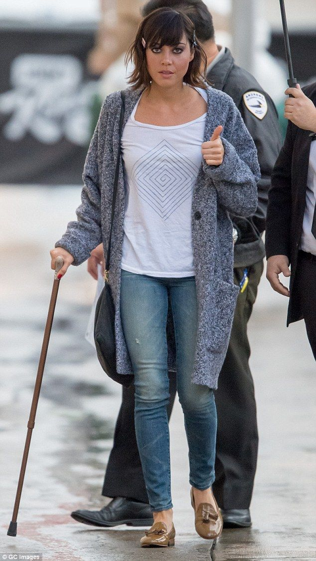 Not giving up: On Tuesday, Aubrey Plaza, 31, gave a thumbs up as she walked with a cane ou...