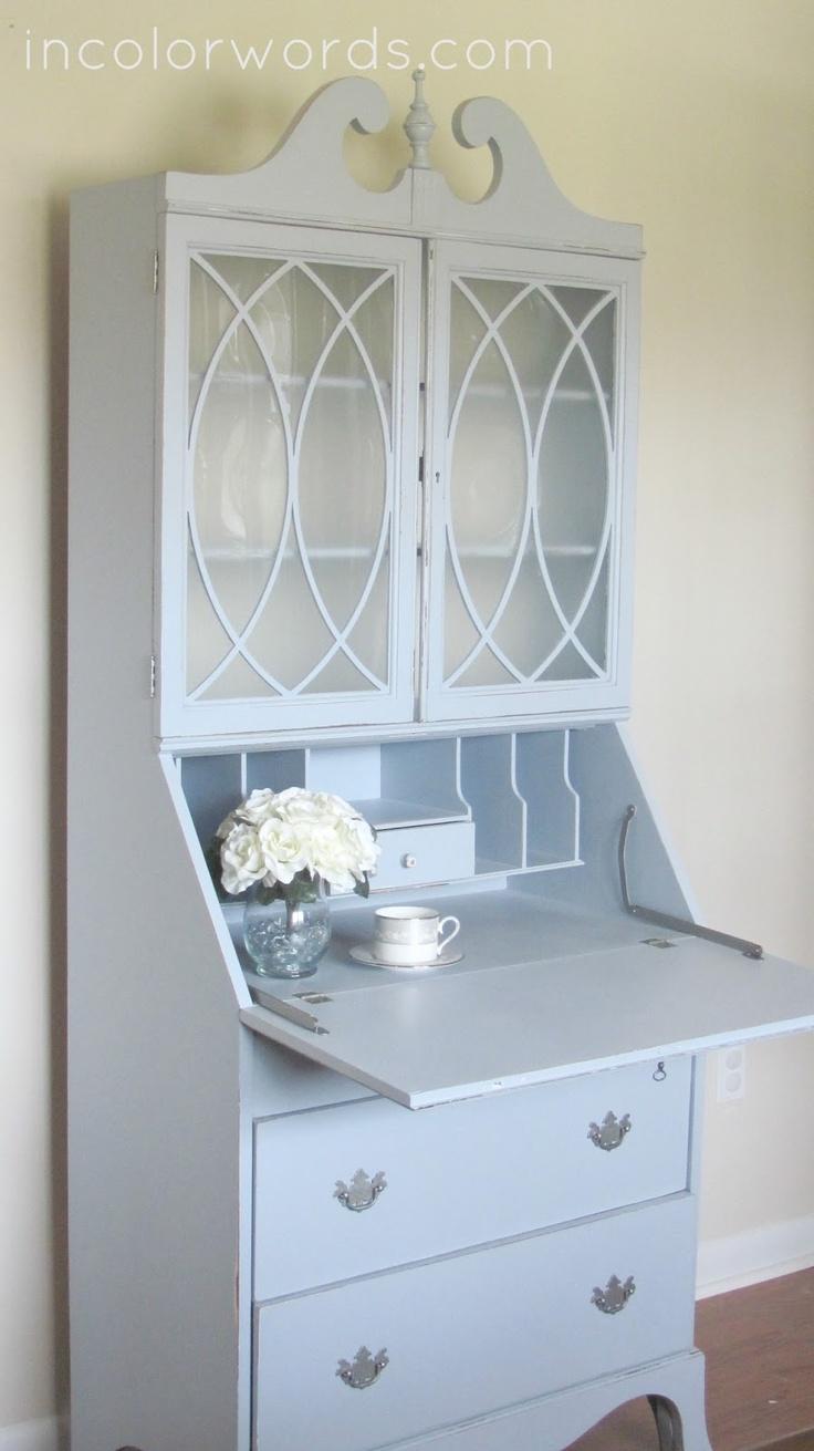 Blue secretary desk. I love the wood detailing on the upper cabinet glass doors.
