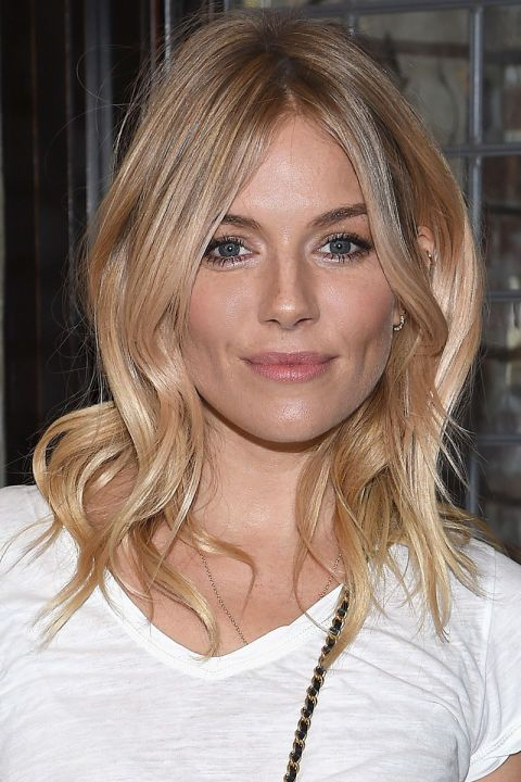 Check out 16 of the best celebrity honey-blonde hair colors, as seen here on Sienna Miller..