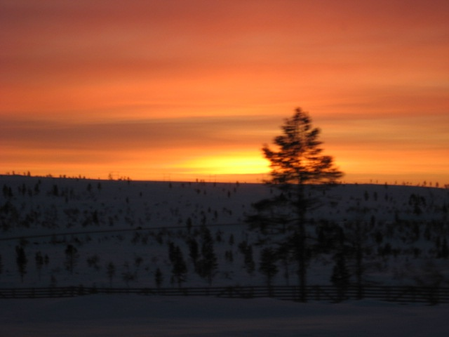 Sunset in Lapland through car's window.