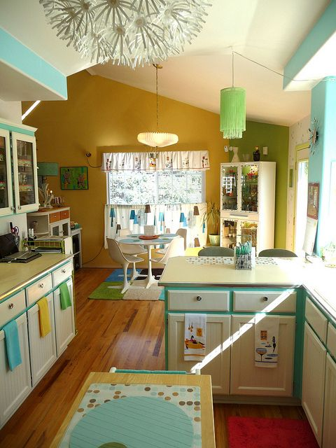 50´s kitchen  love this!  The house was built in the mid 50s and the kitchen cabinets could do with an uplift.  Just wish I was a better painter.