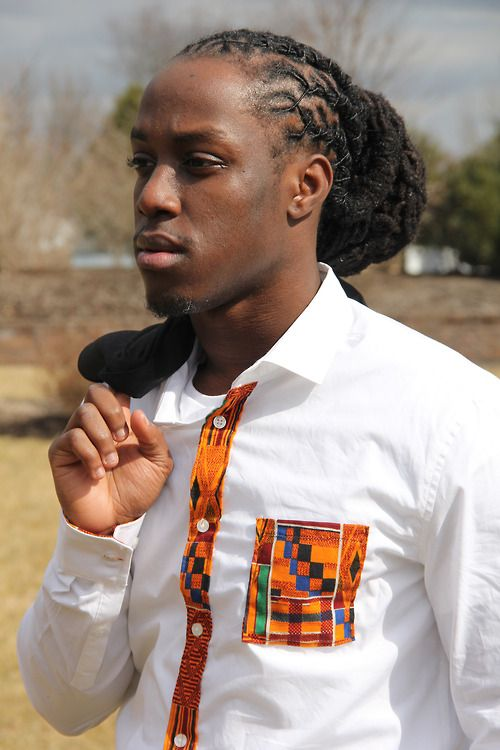 Beautiful black man with locs - kenti trim on a white shirt. New World African...