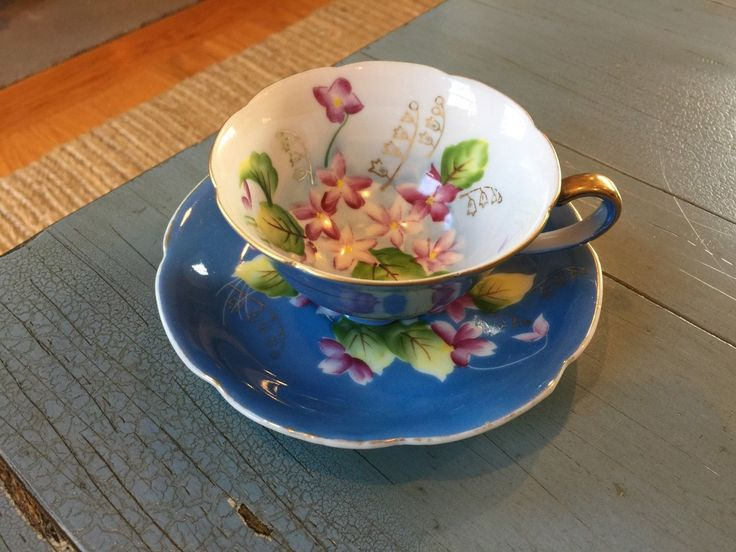 TRIMONT Tea Cup and Saucer Made In Occupied Japan Blue Floral Violets Footed - CAD $19.12. This listing is for a beautiful teacup and saucer made in Occupied Japan by Trimont. The cup has pretty floral and gold designs. The footed cup measures 2 inches tall, and the saucer is 5 1/2 inches across. The set is in very good, vintage condition with wear to the gold paint along the edges and on the handle. Please see my other teacup listings. Thank you! 232681243346