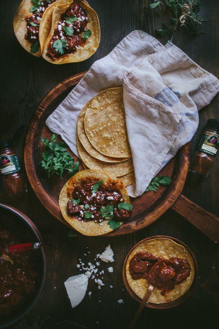 Mole Tacos with cilantro + queso fresco