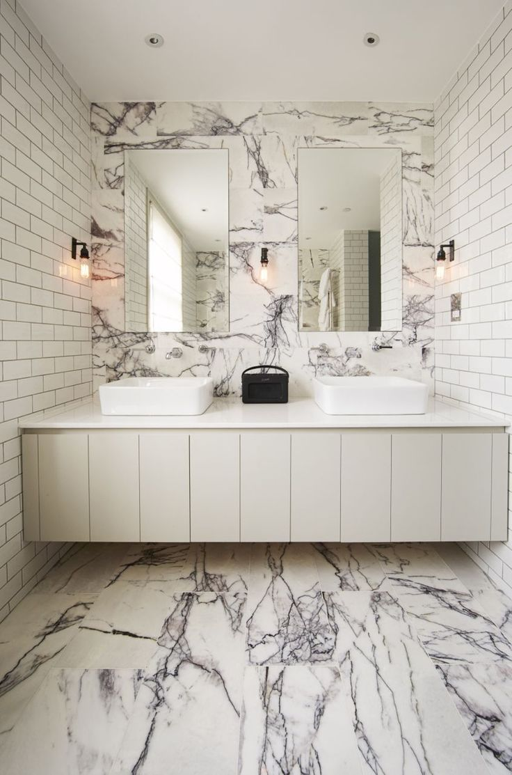 the combo of the crazy marble and plain metro tiles is lovely for the shower room?