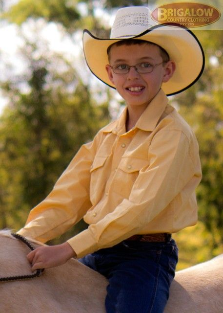 Boys Long Sleeve Western Shirt | Brigalow Country ClothingThese are our flagship shirts here at Brigalow, part of our staple stock line that our customers love. Made from 100% Cotton these shirts are built tough to last longer. Cut with the horse rider in mind these shirts feature longer sleeves, adjustable cuffs, and a long shirt tail.