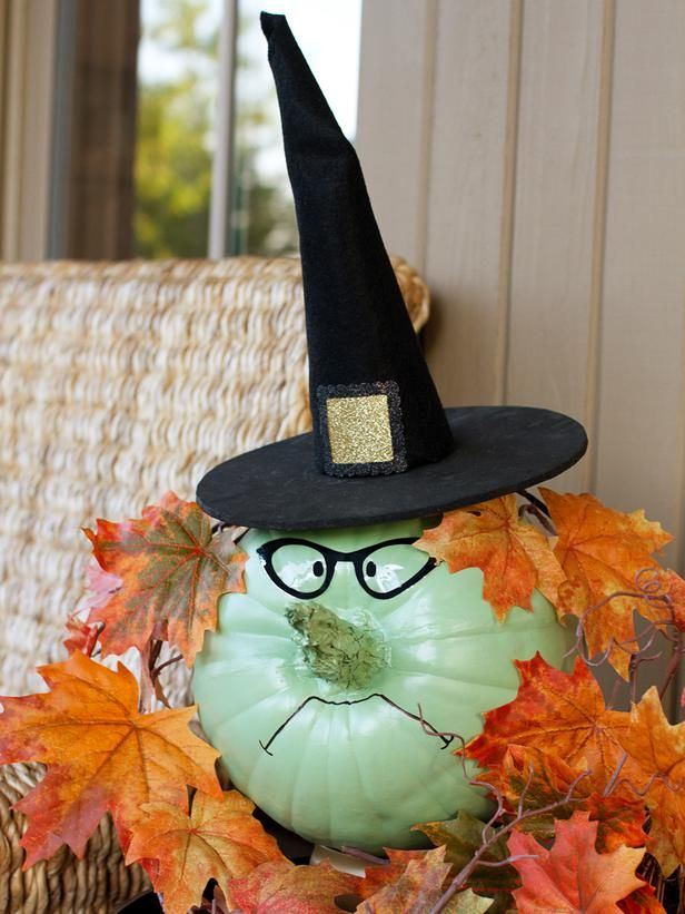 Magic up this not-too-scary witch for your front porch or entryway using a faux pumpkin and basic supplies from the craft store. Create a friendly witch to welcome Halloween guests or a scowling witch to keep mischief-makers at bay.