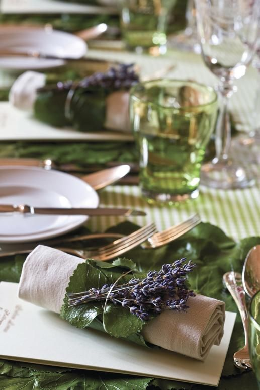 Fresh lavender and leaves used as a napkin ring wrapped around a rustic linen napkin at a French country wedding reception.