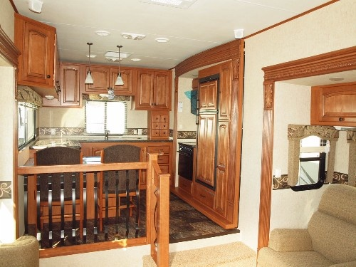 Rear kitchen on a triple slide Big Country 3690SL 5th Wheel by www.lakeshore-rv.com