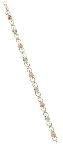 Womens 10k Yellow Gold Filigree Scroll Link Bracelet with 12k Green and Rose Gold in Black Hills Gold Motif, 7.50″ http://www.easterdepot.com/womens-10k-yellow-gold-filigree-scroll-link-bracelet-with-12k-green-and-rose-gold-in-black-hills-gold-motif-7-50/ #easter  Legend has it: Good luck comes to all who wear Black Hills Gold Jewelry.     Graceful 10k filigree scroll work meanders thru the 12K pink and green gold leaves creating this stunning bracelet making it an eye-catching brace..