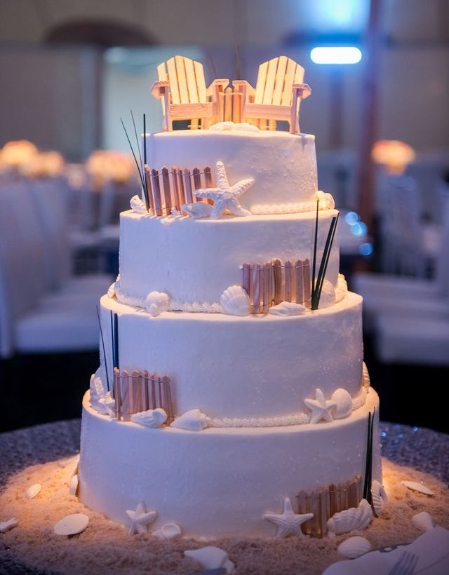 The beach chairs atop this coastal wedding cake look like they're just waiting for a tiny bride and groom to lounge with their toes in the sand! See more coastal cakes from the Casual Gourmet at http://dailycatch.coastalliving.com/2015/06/24/coastal-wedding-cakes-part-ii-cape-cod-edition/