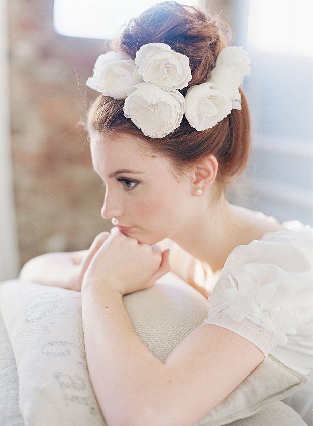 cute topknot bun wedding hairstyle with chiffon flowers