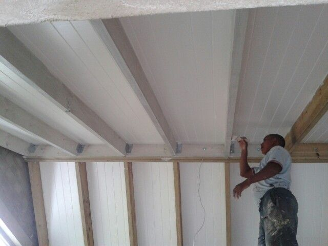 White-washing the exposed timber trusses of our vaulted ceiling