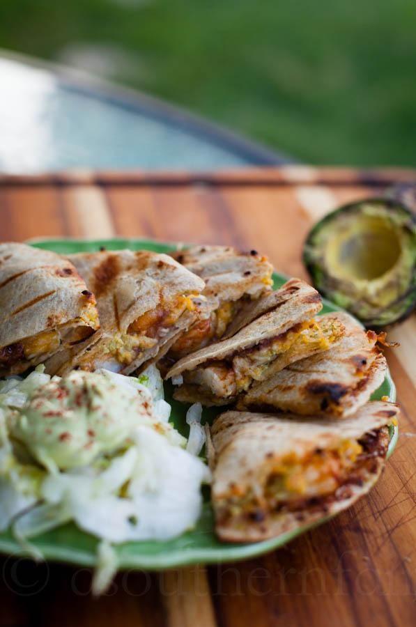 Spicy grilled shrimp quesadillas with smoky avocado cream sauce recipe.