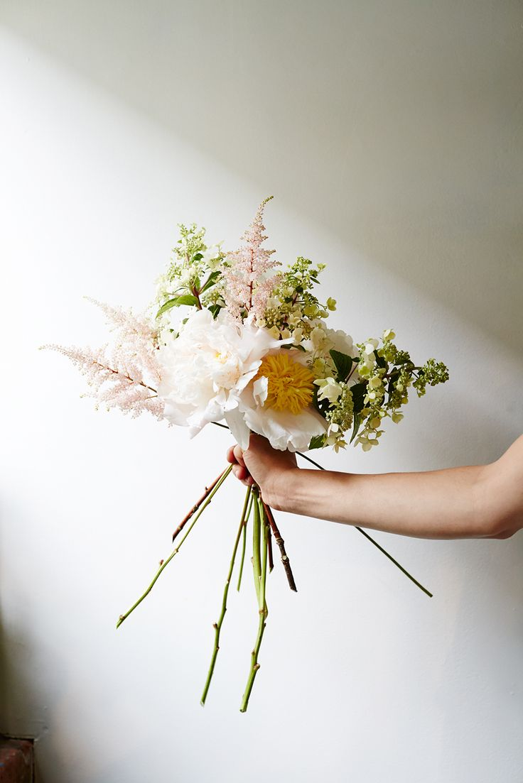 Flower-Arranging Secrets Straight From A Brooklyn Florist #refinery29 http://www.refinery29.com/diy-wedding-bouquets#slide12 After creating the frame, add accent flowers (like the Astilbe, here) throughout.