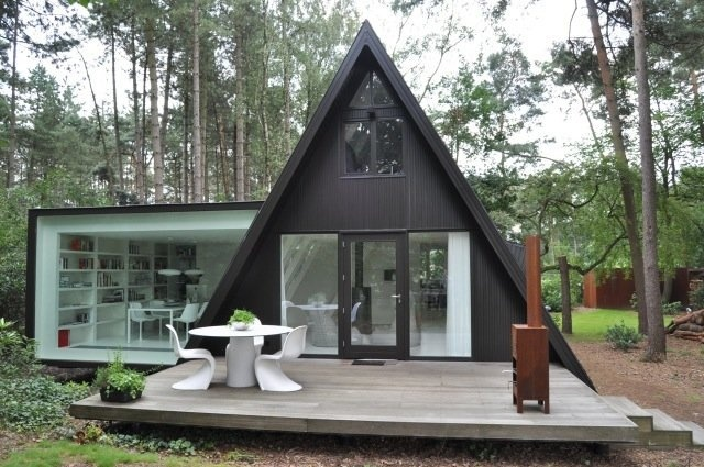 Built in 2011 this black and white A-frame house is full of surprises