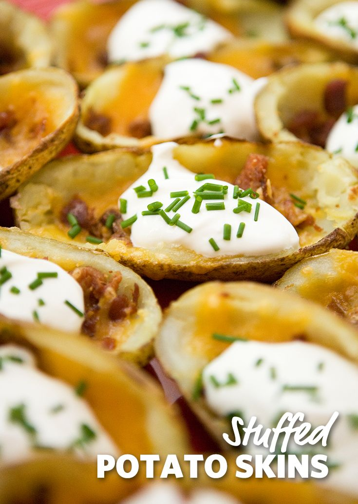 Stuffed Potato Skins: A fan favorite stuffed with bacon, cheese and covered in sour cream. Perfect to make when another recipe calls for potatoes. Grab one or ten! #GameDay