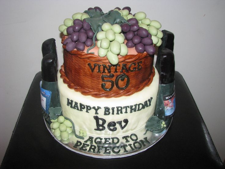 AGED TO PERFECTION - Wine themed cake made to celebrate a 50th birthday!! love how the grapes came out! They looked so real that my family thought the grapers in the tupperware were REAL !!!