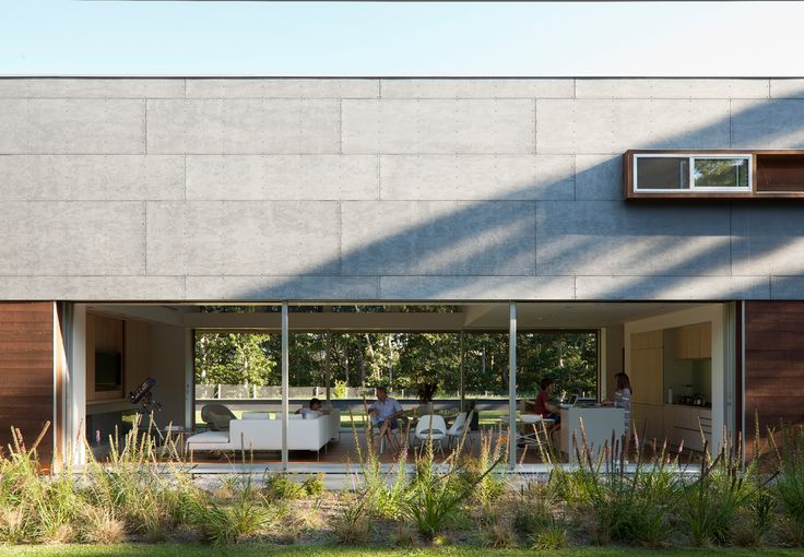 love the concrete panel siding and open through glass living room obviously