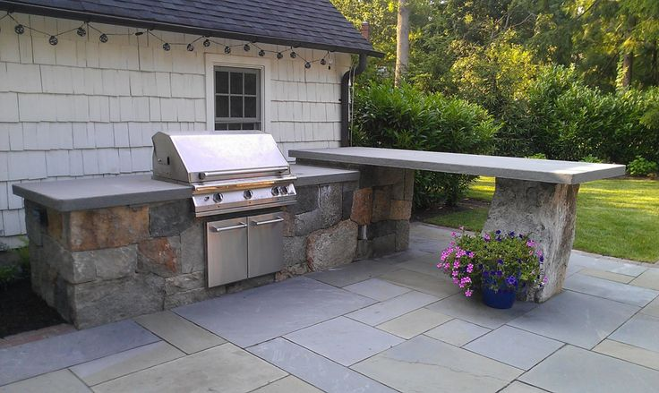 Outdoor Kitchen by Cording Landscape Design l shape with BBQ facing the house and bar top near Dennis'