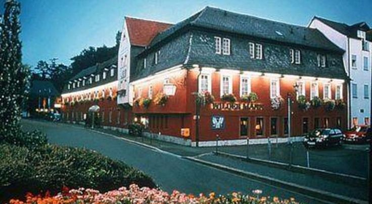 Hotel Wilder Mann Aschaffenburg This hotel is located on the edge of the Spessart nature park in Aschaffenburg. It offers a spa area and a restaurant serving seasonal cuisine.  All rooms at the Hotel Wilder Mann feature cable TV channels and WiFi, free of charge.
